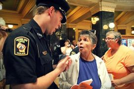 Wisconsin Capitol Police threaten to arrest Tucson tourist - for observing Solidarity Sing Along